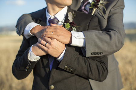 Photo pour Gay couple on their wedding day - image libre de droit