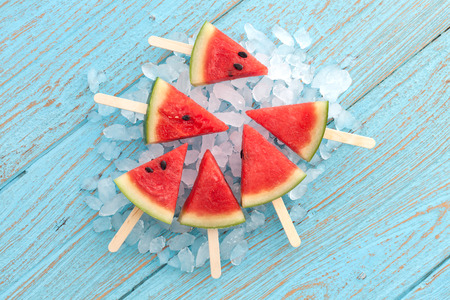 Photo pour watermelon popsicle yummy fresh summer fruit sweet dessert on vintage old wood teak blue - image libre de droit