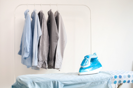Photo pour ironing housework ironed folded shirts clean concept still life garment apparel cloth indoors - image libre de droit