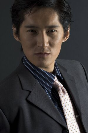 An asian male model in smart casual clothing