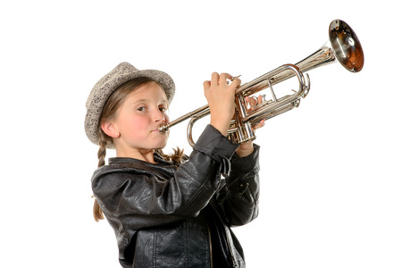 Photo for a pretty little girl with a black jacket and hat plays the trumpet - Royalty Free Image
