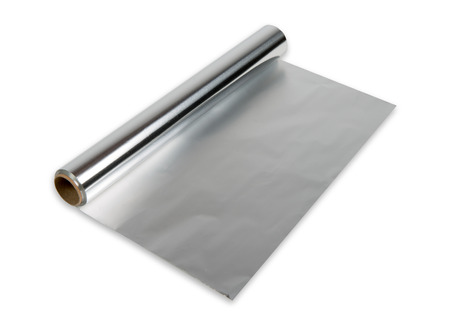 Foto de aluminum foil roll on the white background - Imagen libre de derechos