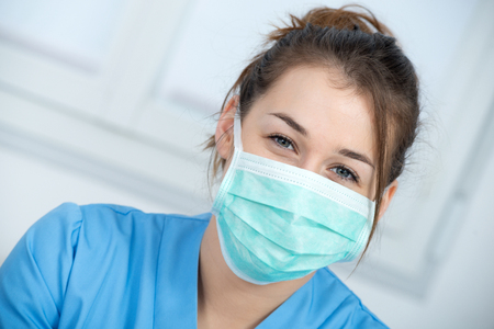 Foto de portrait of a young nurse with a mask - Imagen libre de derechos