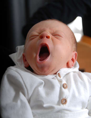 Photo pour portrait of a newborn baby boy yawning - image libre de droit