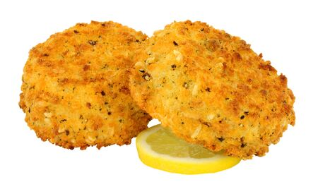 Photo for Breadcrumb covered salmon fish cakes isolated on a white background - Royalty Free Image