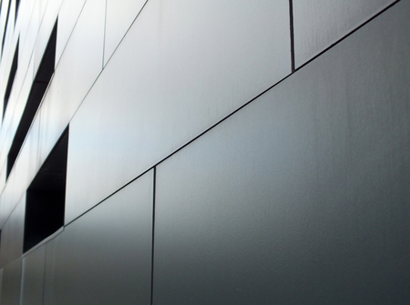 Foto de metallic cladding on modern industrial building - Imagen libre de derechos