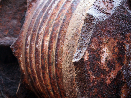 Photo pour A close up of rusting brown steel machinery with rough texture and grooves - image libre de droit