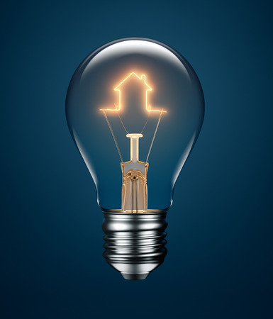 Photo pour Light bulb with filament forming a house icon on blue background - image libre de droit