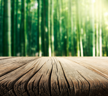 Photo for Empty wooden table with bamboo forest background - Royalty Free Image