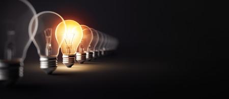 Photo pour Glowing light bulb on dark background - image libre de droit