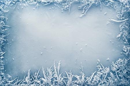 Foto de Frost crystal border on ice - Christmas background - Imagen libre de derechos