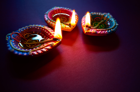 Photo for Colorful clay diya lamps lit during diwali celebration - Royalty Free Image