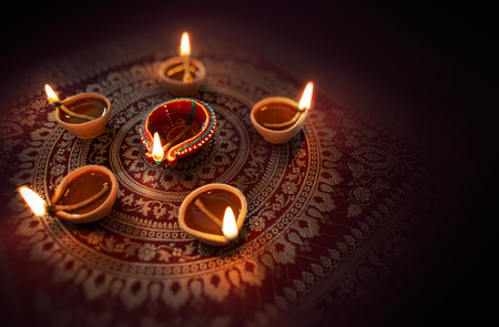 Foto de Happy Diwali - Diya lamps lit during diwali celebration - Imagen libre de derechos