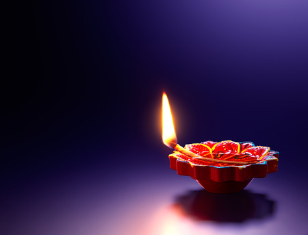 Photo for Happy Diwali - Red diya oil lamp on purple background - Royalty Free Image
