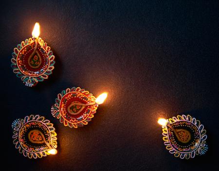 Photo for Happy Diwali - Colorful Diya lamp on floor - Royalty Free Image