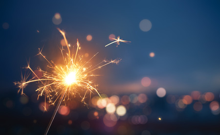 Photo for Sparkler with blurred busy city light background - Royalty Free Image