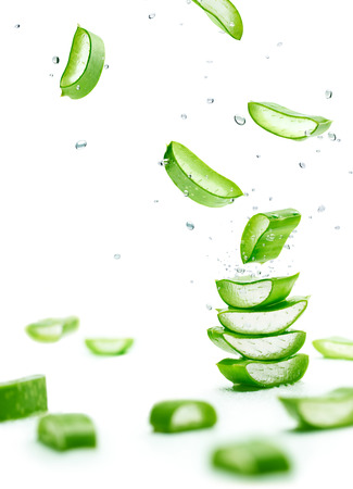 Photo for Aloe Vera slices stacked with water splash over white - Royalty Free Image