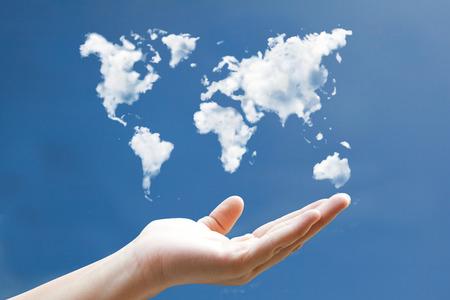 Photo pour world map cloudshape floting on hand - image libre de droit