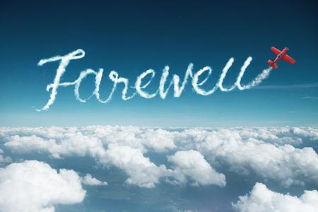 Foto de farewell word created from a trail of smoke by Acrobatic plane. - Imagen libre de derechos