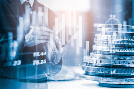 Foto de Double exposure businessman and stock market or forex graph suitable for financial investment concept. Economy trends background for business idea and all art work design. Abstract finance background. - Imagen libre de derechos