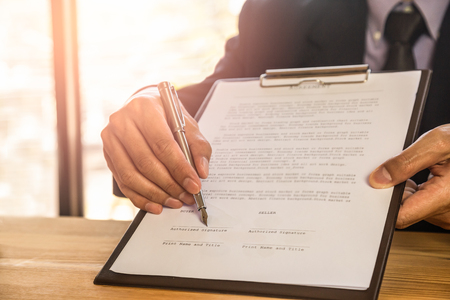 Foto de Business man signing a contract. Owns the business sign personally, director of the company, solicitor. Real estate agent holding house, financial or renting property, merger and acquisition concept. - Imagen libre de derechos