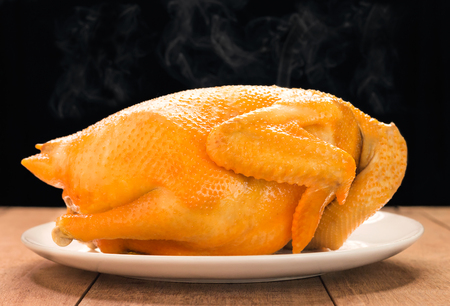 Photo for Whole boiled chicken on wooden table, Chinese cuisine - Royalty Free Image