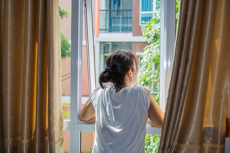 Photo for one lady look at outside the window - Royalty Free Image