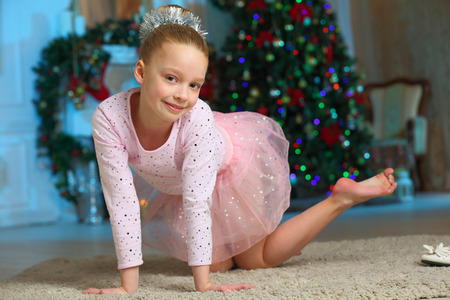 Photo pour Pretty charming beautiful artistic blond baby girl in Christmas costumes. Beautiful blonde child girl in a New Year's pink suit snowflakes. - image libre de droit