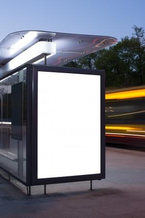 Foto de Blank billboard on bus stop at night  - Imagen libre de derechos
