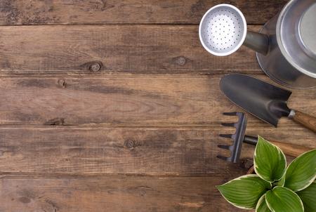 Foto de Gardening tools o wooden background with copy space  - Imagen libre de derechos