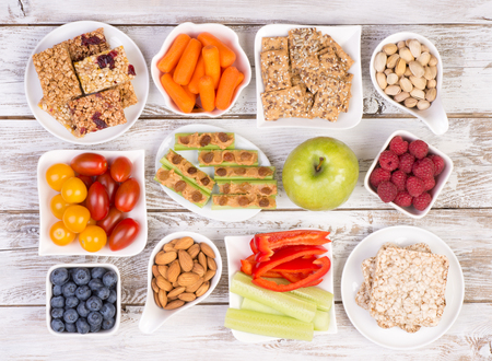 Photo for Healthy snacks on wooden table, top view - Royalty Free Image