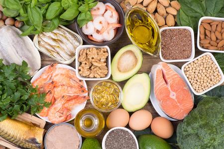 Foto de Food sources of Omega 3 fatty acids such as grains, fruit, vegetables and fish, top view - Imagen libre de derechos
