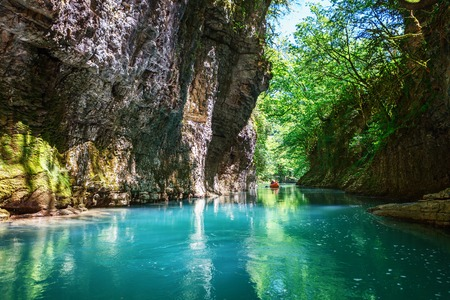 Photo pour Martvili canyon in Georgia. Beautiful natural canyon with view of the mountain river, christal blue water and boat ride near Kutaisi - image libre de droit