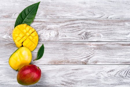 Photo for Mango. Tropical Fruits. On a wooden background. Top view. Copy space - Royalty Free Image