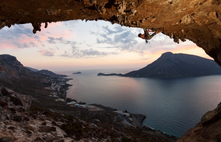 Silhouette of a rock climber against picturesque view of Telendos Island at sunset  Kalymnos Island, Greece