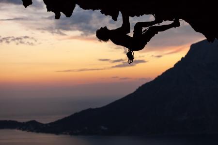 Silhouette of a rock climber at sunset  Kalymnos Island, Greece