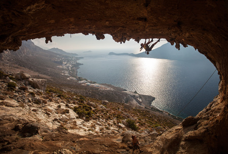Family rock climber against picturesque view of Telendos Island at sunset  Kalymnos Island, Greece