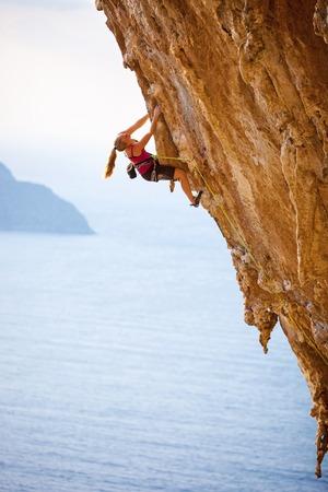 Family rock climber at sunset. Kalymnos Island, Greece.