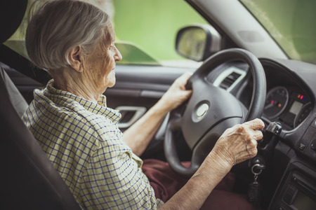 Photo for Senior woman driving a car - Royalty Free Image