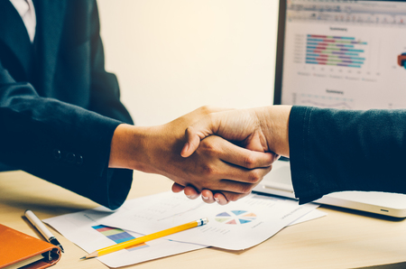 Photo for Handshake between joint venture businessmen after good management and have good concept  - Royalty Free Image
