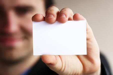 Photo pour Businessman holding his business card in hand - image libre de droit