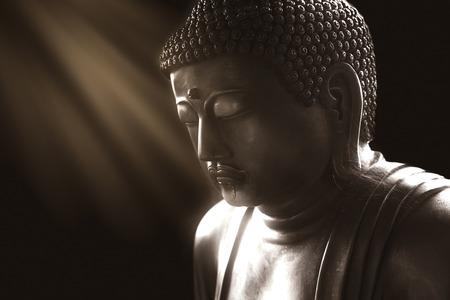 Foto de calm buddha with light of wisdom, peacful asian buddha zen tao religion art style statue. - Imagen libre de derechos