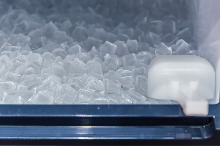 Foto de clean cool ice block from ice making machine for cooling fresh drinking in hot summer season. - Imagen libre de derechos