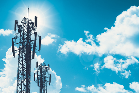 Photo for communication tower or 3G 4G network telephone cellsite silhouette on blue sky and space for text - Royalty Free Image