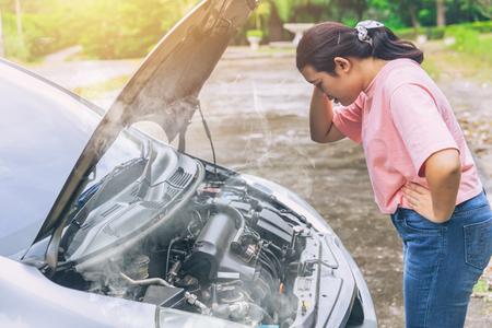 Foto de asian women worry and stress a trouble with car engine crash overheat - Imagen libre de derechos