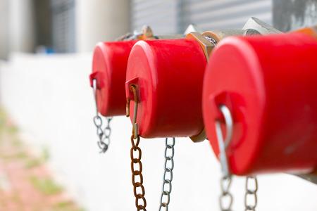 Photo pour row fire hydrant closeup red cap - image libre de droit