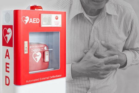 Foto de AED or Automated External Defibrillator first aid device for help people stroke or heart attack in public space - Imagen libre de derechos