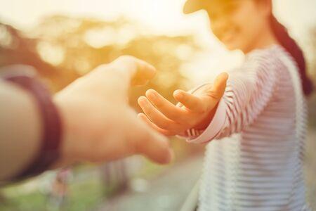 Foto de Girl teen smiling and reach her hand. Help Touch Care Support be a Good Friend with Love concept. - Imagen libre de derechos