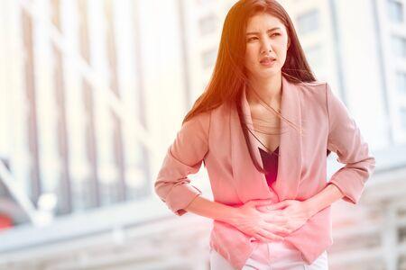 Foto de Asian woman front stomach painful sign of Ovarian Endometriosis and Chocolate Cyst syndrome. - Imagen libre de derechos