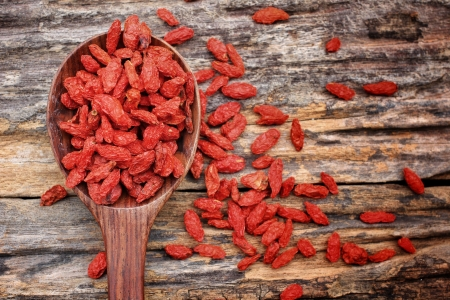 Photo for Red dried goji berries on wood background - Royalty Free Image